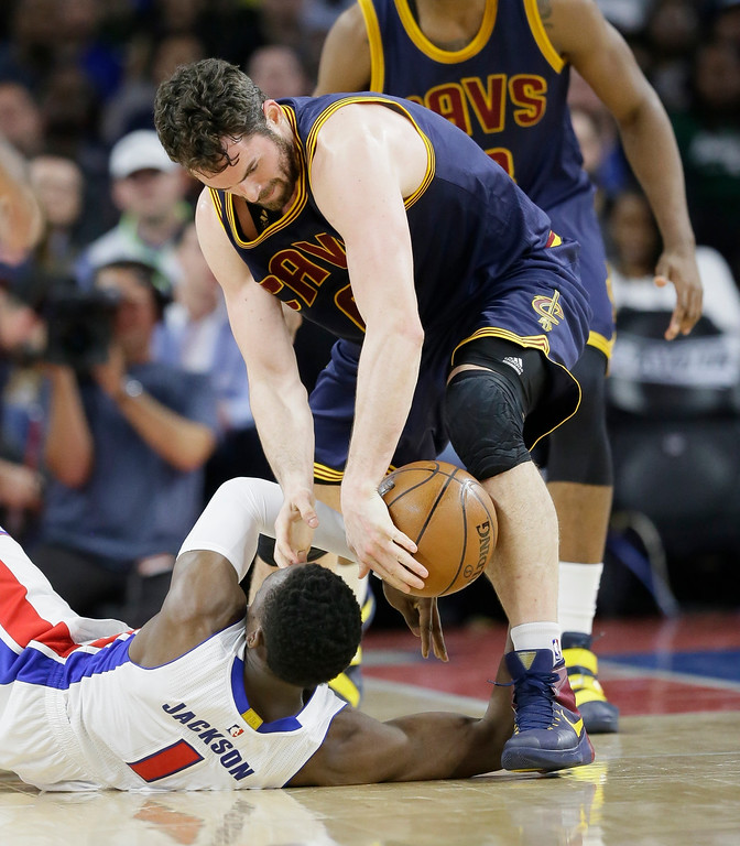 . Cleveland Cavaliers forward Kevin Love reaches in as Detroit Pistons guard Reggie Jackson (1) looses control of the ball during the first half in Game 4 of a first-round NBA basketball playoff series, Sunday, April 24, 2016 in Auburn Hills, Mich. (AP Photo/Carlos Osorio)