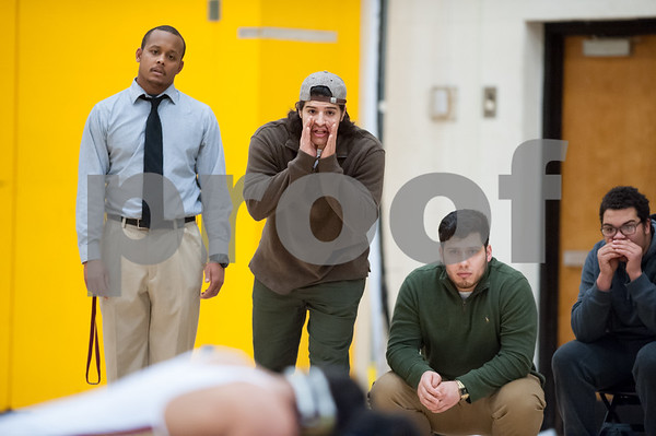 01/10/18 Wesley Bunnell | Staff New Britain wrestling defeated Newington on Wednesday evening at New Britain High School . The New Britain coaching staff including Jordan Jacquo, 3rd from R, looks on.