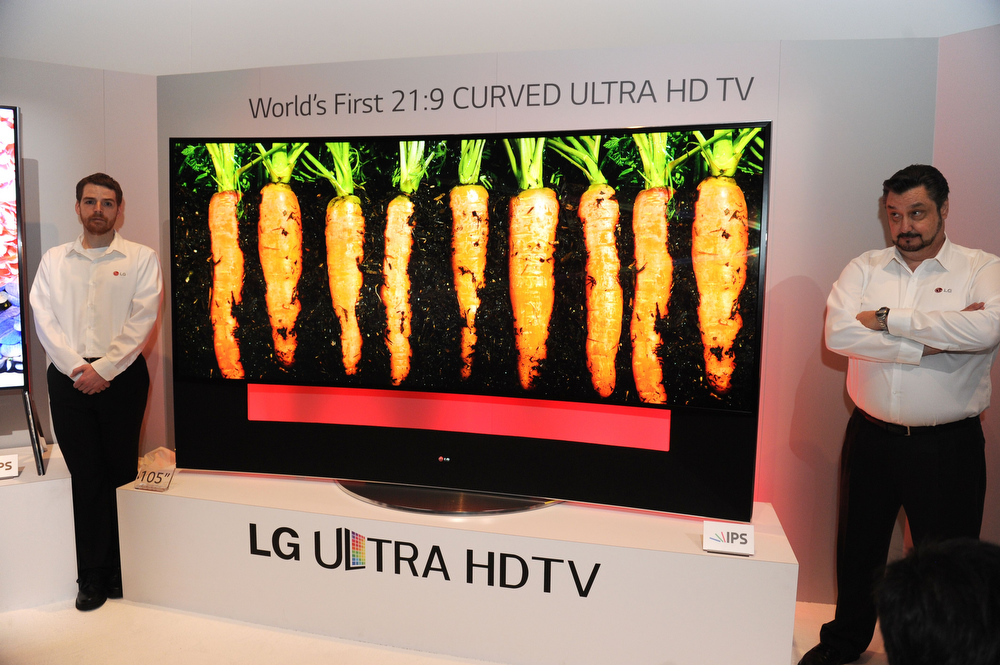Description of . LG's ultra HD television with 105-inch curved display is seen at the LG press conference at the Mandalay Bay Convention Center for the 2014 International CES on January 6, 2014 in Las Vegas, Nevada.  ROBYN BECK/AFP/Getty Images