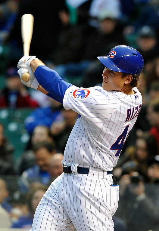 . Chicago Cubs\' Anthony Rizzo flies out against the Colorado Rockies during the first inning of a baseball game Monday, May 13, 2013, in Chicago. (AP Photo/Jim Prisching)