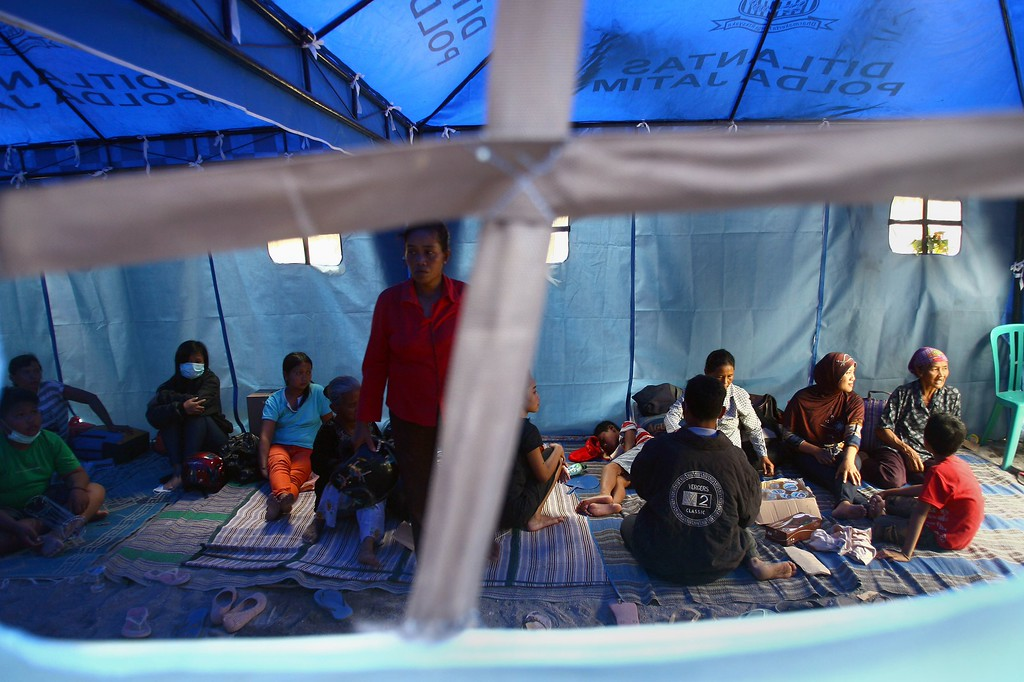 . Indonesian residents displaced by the volcanic eruption of Mount Kelud in East Java on February 13 rest inside a tent at an evacuation centre in Kediri on February 16, 2014. AFP PHOTO/JUNI  KRISWANTO/AFP/Getty Images