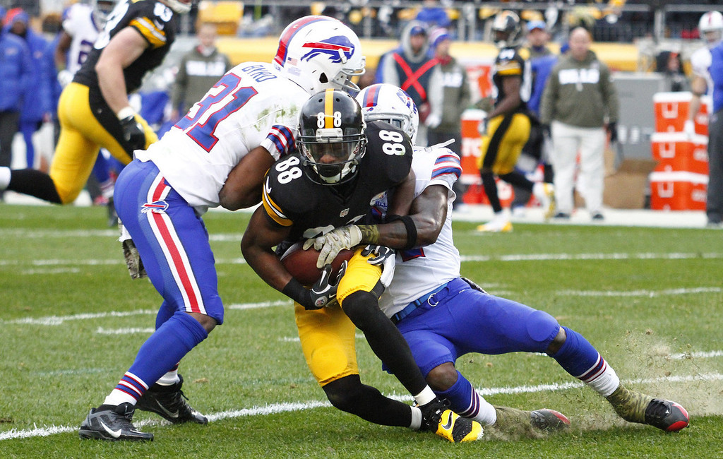 . Emmanuel Sanders #88 of the Pittsburgh Steelers is tackled by Jairus Byrd #31 of the Buffalo Bills during the game on November 10, 2013 at Heinz Field in Pittsburgh, Pennsylvania.  (Photo by Justin K. Aller/Getty Images)