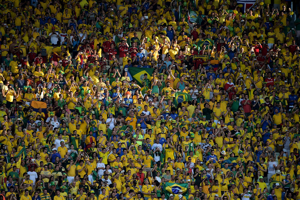 . Fans cheer before the quarter-final football match between Brazil and Colombia at the Castelao Stadium in Fortaleza during the 2014 FIFA World Cup on July 4, 2014. GABRIEL BOUYS/AFP/Getty Images