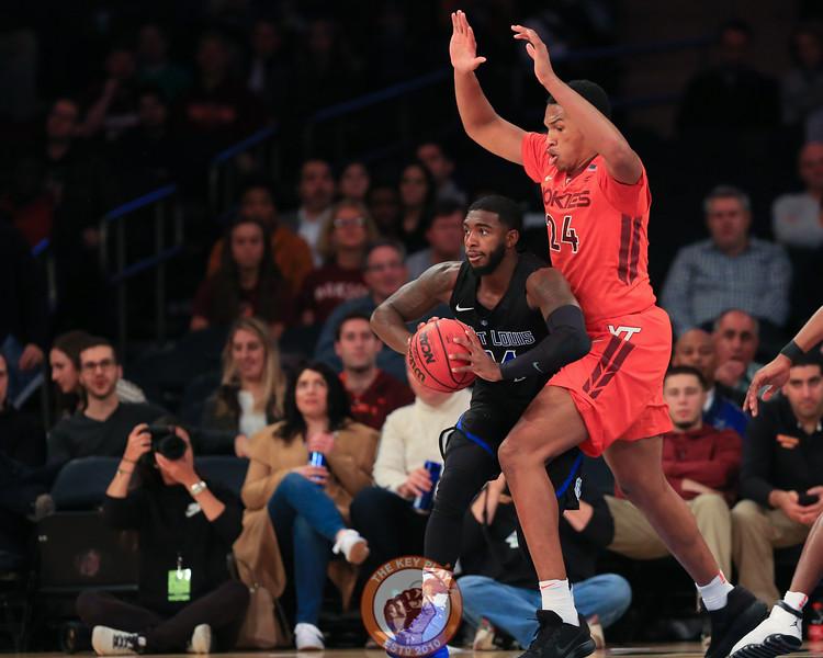 Virginia Tech's forward Kerry Blackshear Jr. (24) defends St. Louis' guard Aaron Hines (24) in Madison Square Garde, Nov. 16, 2017. St. Louis upset Virginia Tech with a 77-71 win.