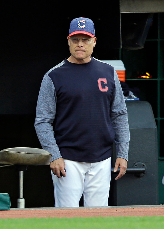 . Cleveland Indians acting manager Brad Mills watches in the third inning of a baseball game against the San Diego Padres, Tuesday, July 4, 2017, in Cleveland. Indians manager Terry Francona has been admitted to Cleveland Clinic for tests. (AP Photo/Tony Dejak)