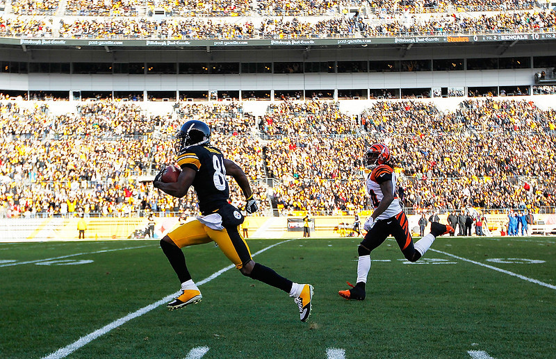 . Antonio Brown #84 of the Pittsburgh Steelers runs by Adam Jones #24 of the Cincinnati Bengals for the touchdown in the first half after catching a pass during the game at Heinz Field on December 23, 2012 in Pittsburgh, Pennsylvania. (Photo by Jared Wickerham/Getty Images)