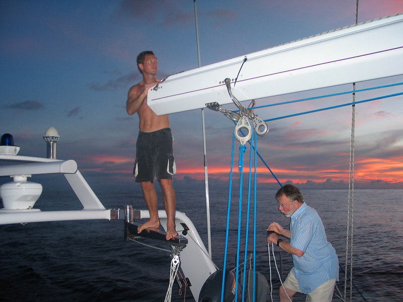 Sailing from Bora Bora to Hawaii -- Callum and Steve inspecting the broken tension rod in the in boom furling system.