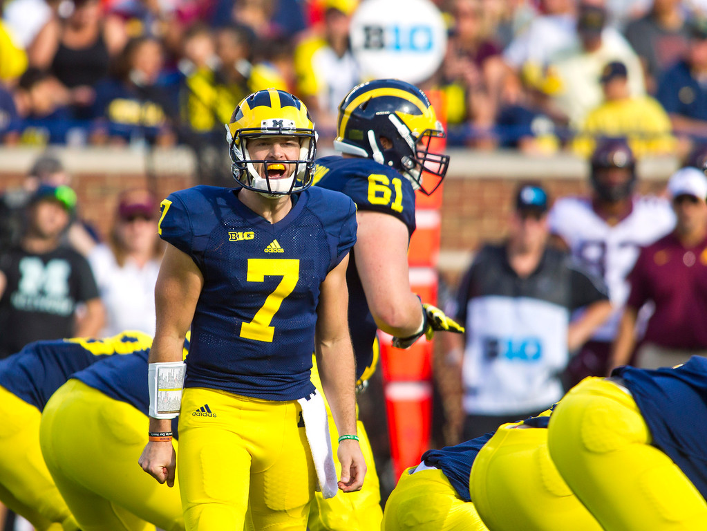. Michigan quarterback Shane Morris (7) shouts at his offensive line in the second quarter of an NCAA college football game against Minnesota in Ann Arbor, Mich., Saturday, Sept. 27, 2014. (AP Photo/Tony Ding)