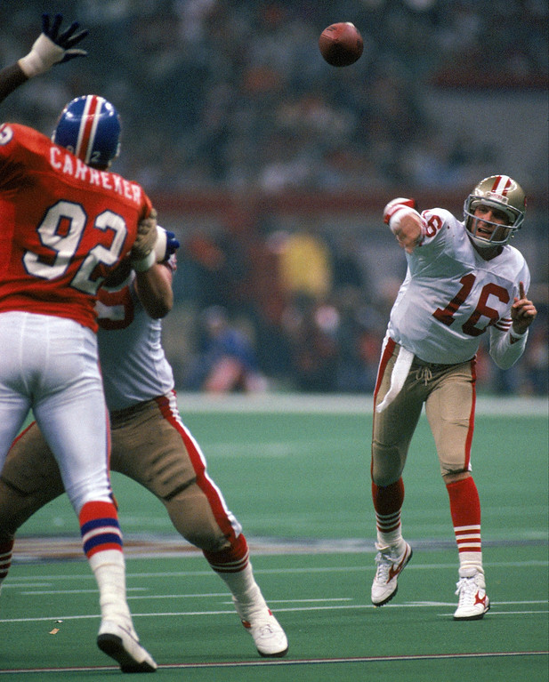 . Quarterback Joe Montana #16 of the San Francisco 49ers fires an incomplete pass towards Mike Wilson in the third quarter in Super Bowl XXIV against the Denver Broncos at Louisiana Superdome on January 28, 1990 in New Orleans, Louisiana.  The 49ers won 55-10.  (Photo by George Rose/Getty Images)