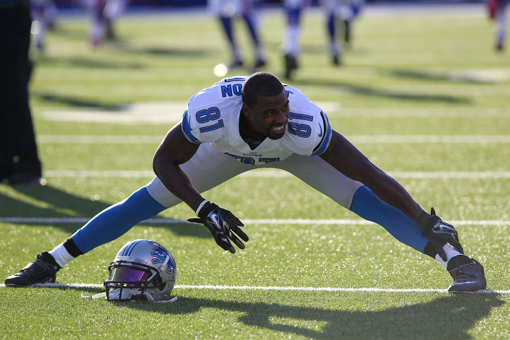 . Detroit Lions wide receiver Calvin Johnson stretches before a preseason NFL football game against the Buffalo Bills, Thursday, Aug. 28, 2014, in Orchard Park, N.Y. (AP Photo/Bill Wippert)