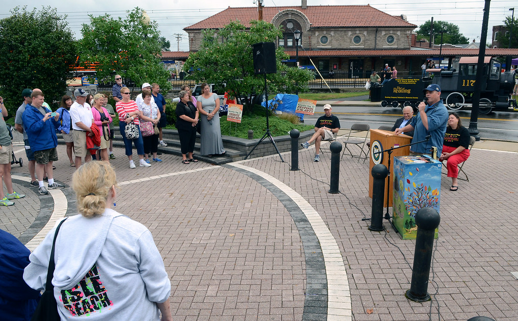 . The Lansdale Borough Lifetime Achievement Award is presented to the family of Stephen Frederick during the Lansdale Founders Day celebration and on Saturday August 23,2014. Photo by Mark C Psoras/The Reporter