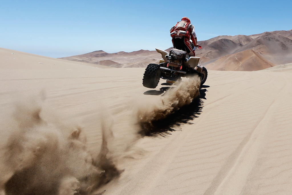 . IQUIQUE, CHILE - JANUARY 09:  #251 Rafal Sonik of Poland for Sonik Team YFM700R Raptor Yamaha compete during day 6 of the Dakar Rallly between Antofaasta and Iquique on January 9, 2015 near Iquique, Chile.  (Photo by Dean Mouhtaropoulos/Getty Images)