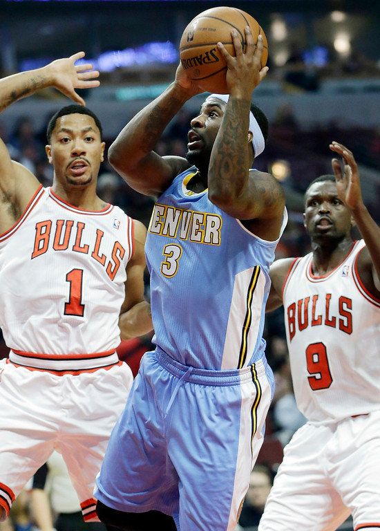 . Denver Nuggets guard Ty Lawson (3) goes up for a shot as Chicago Bulls guard Derrick Rose (1) and forward Luol Deng (9) look on during the first half of an NBA preseason basketball game in Chicago on Friday, Oct. 25, 2013. (AP Photo/Nam Y. Huh)