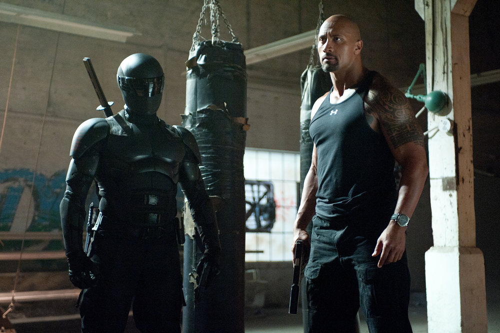 . Left to right: Ray Park plays Snake Eyes and Dwayne Johnson plays Roadblock in G.I. JOE: RETALIATION, from Paramount Pictures, MGM, and Skydance Productions. (Jaimie Trueblood/Paramount Pictures)