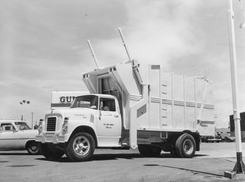 "This unusual looking truck is one of two sold to the U.S. Air Force Academy in 1958. The model BF-16-FL (Full-Pack) features side forks and two 6-1/4"" cylinders that operate the packer blade. These Bowles full-pack models were listed as having telescopic packing cylinders, but this short-bodied version may have been able to make use of single-stage rams instead."