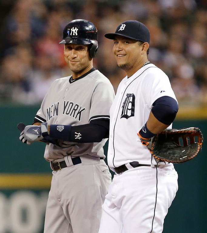 . New York Yankees\' Derek Jeter, left, laughs with Detroit Tigers first baseman Miguel Cabrera after hitting a single in the first inning of a baseball game in Detroit Tuesday, Aug. 26, 2014. (AP Photo/Paul Sancya)