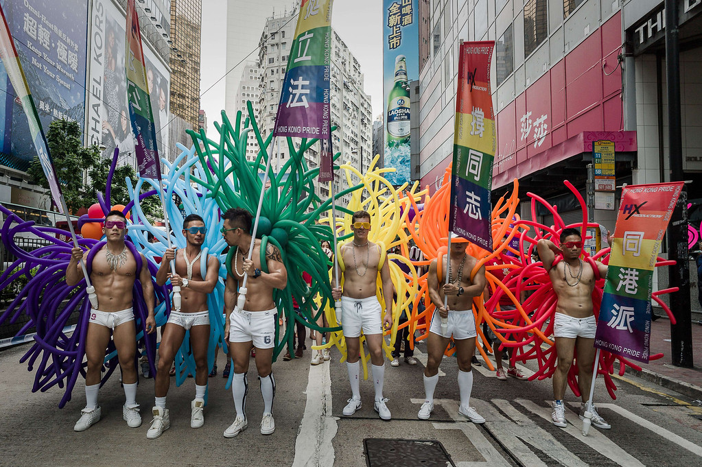 . Participants hold flags during the gay pride parade in Hong Kong on November 9, 2013. Despite its reputation as an international financial hub, critics say Hong Kong remains a conservative city when it comes to gay rights, lacking protection for the sexual minority group despite having decriminalised homosexuality in 1991. PHILIPPE LOPEZ/AFP/Getty Images