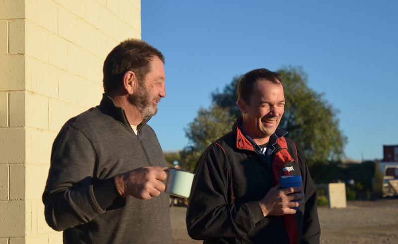 Dave Law and Bob Condon making the most of an early morning coffee at Blinman, SA.