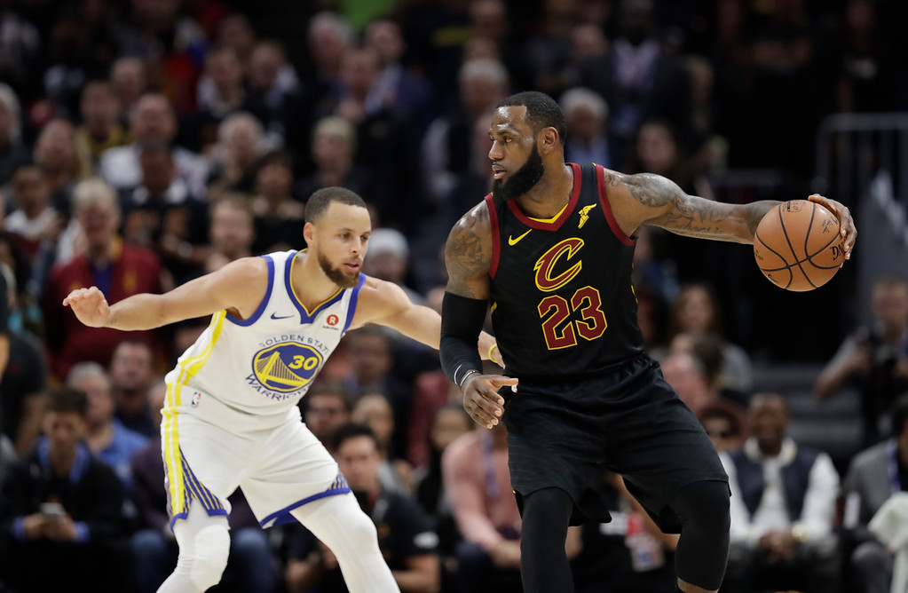 . Cleveland Cavaliers\' LeBron James is defended by Golden State Warriors\' Stephen Curry in the first half of Game 3 of basketball\'s NBA Finals, Wednesday, June 6, 2018, in Cleveland. (AP Photo/Tony Dejak)
