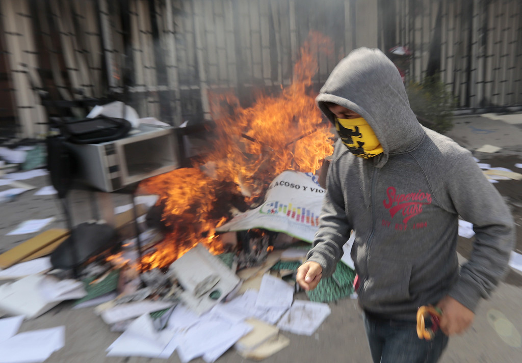 . Protesters set on fire the Education Secretararyship\'s Finance Office in Chilpancingo, Guerrero State, Mexico on November 12, 2014. Pedro PARDO/AFP/Getty Images