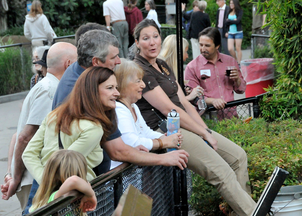 . Los Angeles Zoo keepers, like the one at right, shared their vast animal knowledge with guests at the Greater Los Angeles Zoo Association\'s Sunset Safari. (Photo by George Stoneman for the Daily News)