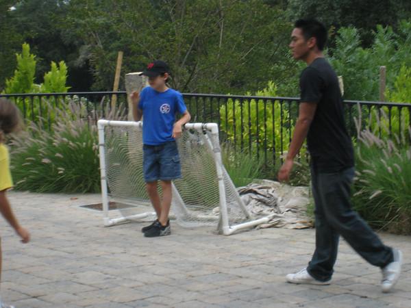 Driveway soccer w the Phan/Nguyen cousins