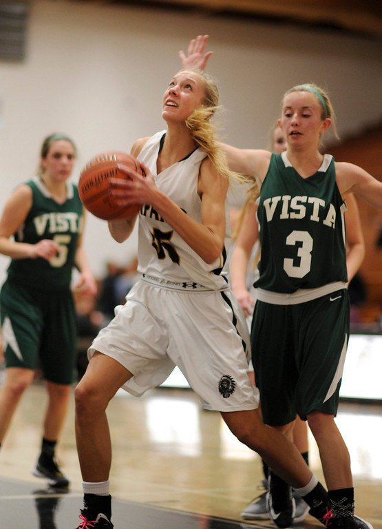 . Arapahoe\'s Molly Reidel (55), left, makes a basket by Mountain Vista\'s Karlee Schwartzkopf (3) in the second half of the game at Arapahoe High School Gym onSaturday, Jan. 5, 2013, in Centennial, Colo. Arapahoe won 74-38. Hyoung Chang, The Denver Post