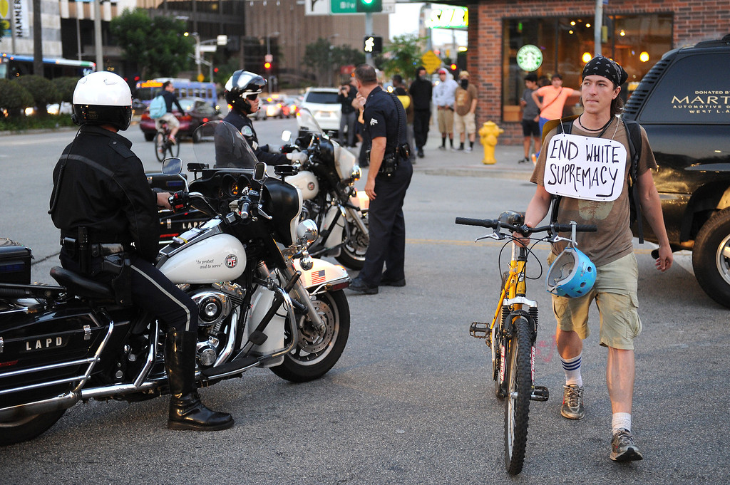 """. LAPD personnel gather on Westwood Boulevard after arresting a protester during a \""""Smash White Supremacy Fun Run\"""" in Westwood, Thursday, July 18, 2013. (Michael Owen Baker/L.A. Daily News)"""