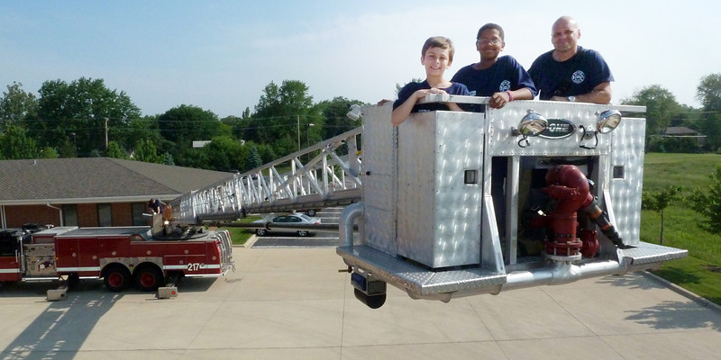 Tracey with Firefighter's for the day June 2011.jpg
