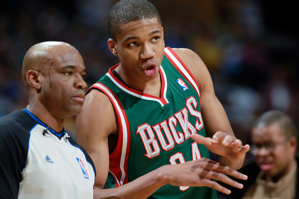 . Milwaukee Bucks forward Giannis Antetokounmpo, right, of Greece, argues with referee Tre Maddox after being called for a foul against the Denver Nuggets in the fourth quarter of the Nuggets\' 110-100 victory in an NBA basketball game in Denver on Wednesday, Feb. 5, 2014. (AP Photo/David Zalubowski)