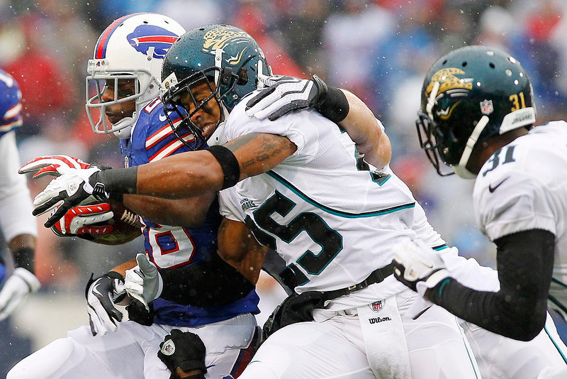 . Jacksonville Jaguars\' Dwight Lowery tackles Buffalo Bills\' C.J. Spiller, left, during the first half of an NFL football game Sunday, Dec. 2, 2012 in Orchard Park, N.Y. (AP Photo/Bill Wippert)