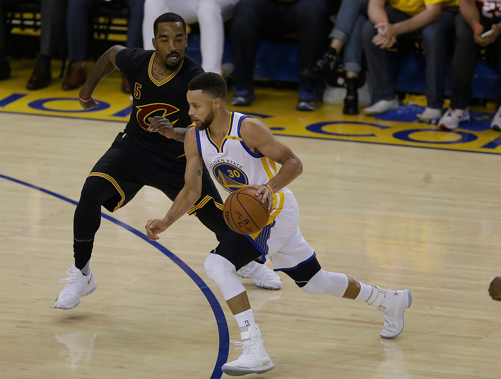 . Golden State Warriors guard Stephen Curry (30) drives on Cleveland Cavaliers guard J.R. Smith (5) during the first half of Game 5 of basketball\'s NBA Finals in Oakland, Calif., Monday, June 12, 2017. (AP Photo/Ben Margot)