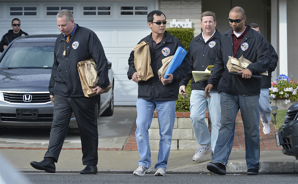 . Members of the Orange County Regional Computer Forensics Lab leave the home of the mother of alleged triple-murderer  Christopher Dorner in La Palma, California on February 8, 2013.