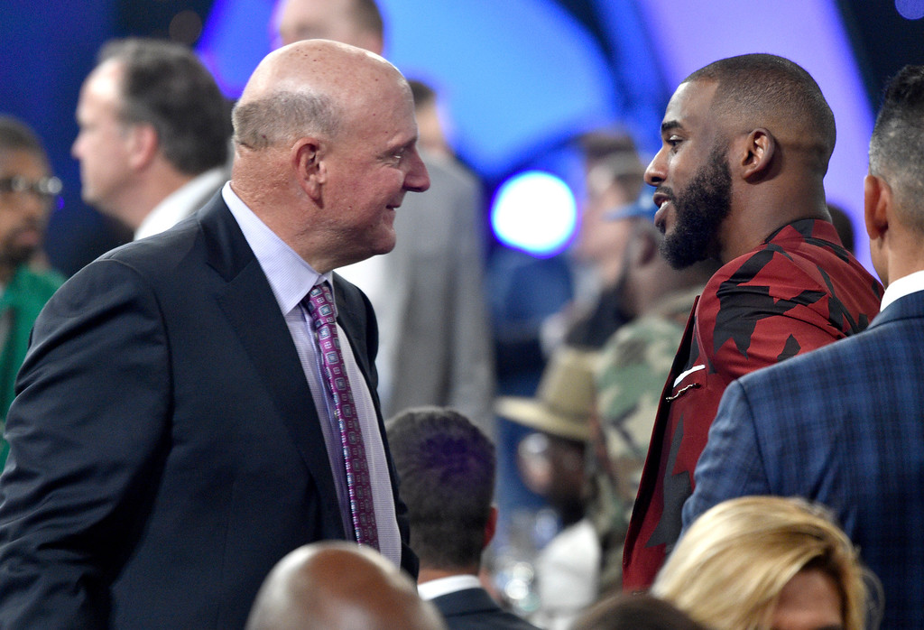 . Steve Ballmer, owner of the Los Angeles Clippers, left, speaks with NBA player Chris Paul, of the Houston Rockets, in the audience at the NBA Awards on Monday, June 25, 2018, at the Barker Hangar in Santa Monica, Calif. (Photo by Chris Pizzello/Invision/AP)