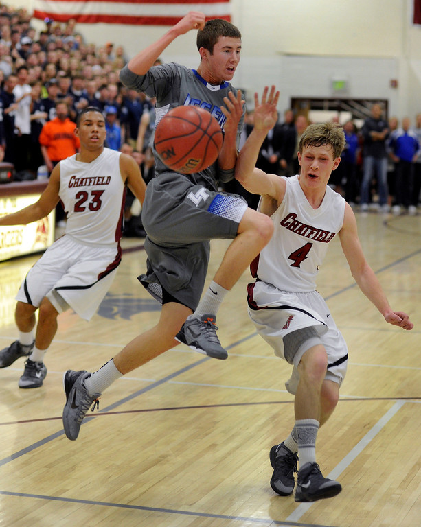 . LITTLETON, CO. - MARCH 6: Legend point guard Riley Matticks (11) had the ball knocked from his hands by Chatfield defender Andrew St. Germain (4) in the first half. The Legend High School boy\'s basketball team upset Chatfield 51-49  in a playoff game Wednesday night, March 6, 2013. (Photo By Karl Gehring/The Denver Post)
