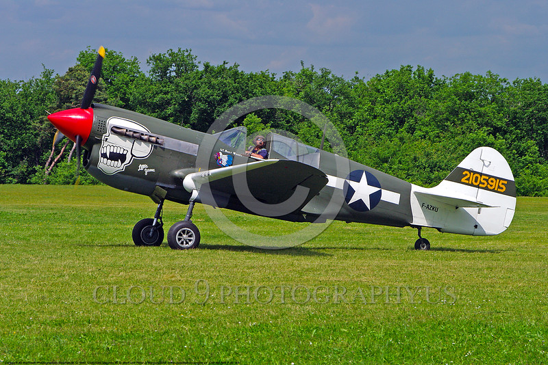 WB-Curtiss P-40 Warhawk 00161 A Curtiss P-40 Warhawk USA WWII era fighter holds for take-off warbird picture by Stephen W. D. Wolf.JPG
