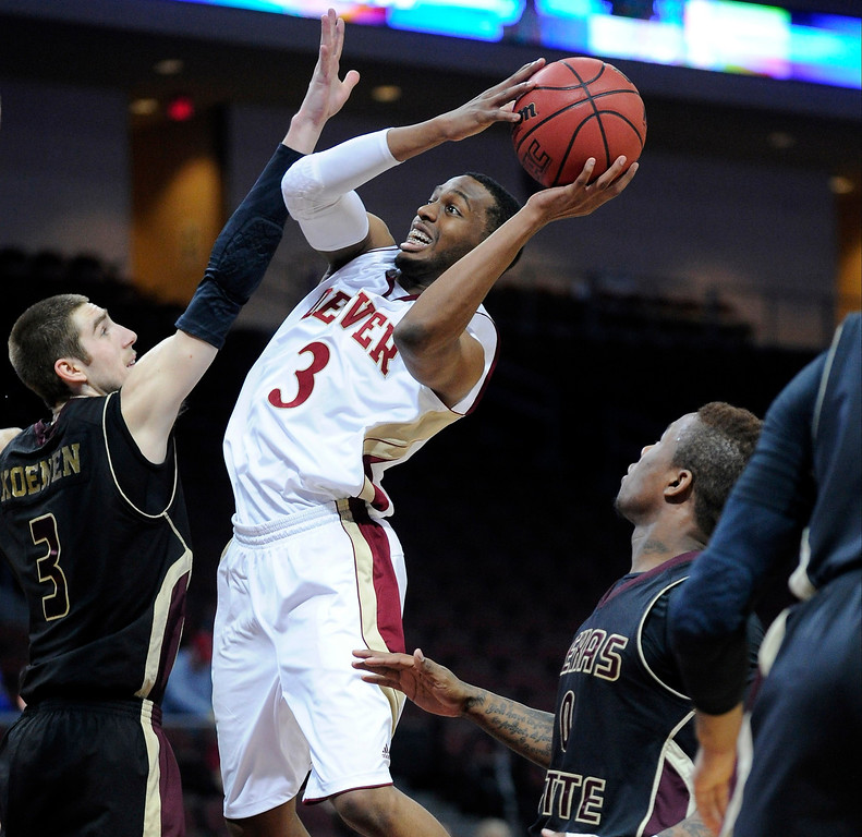 . Denver\'s Jalen Love (3) shoots against Texas State\'s Reid Koenen (3) during the second half of a Western Athletic Conference tournament NCAA college basketball game on Thursday, March 14, 2013 in Las Vegas. Texas State won 72-68. (AP Photo/David Becker)