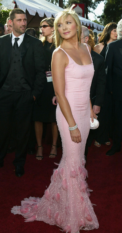 """. Kim Cattrall nominated for Outstanding Supporting Actress in a Comedy Series for \""""Sex and the City\"""" attends the 56th Annual Primetime Emmy Awards at the Shrine Auditorium September 19, 2004 in Los Angeles, California. (Photo by Kevin Winter/Getty Images)"""