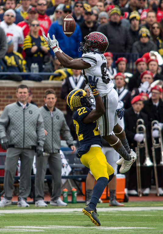 . Ohio State wide receiver Terry McLaurin (83) bobbles a reception attempt over Michigan defensive back David Long (22) in the first quarter of an NCAA college football game in Ann Arbor, Mich., Saturday, Nov. 25, 2017. (AP Photo/Tony Ding)