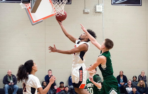 02/07/20 Wesley Bunnell | StaffrrGoodwin Tech boys basketball defeated Cheney Tech at home on Friday February 7, 2020. Luis Aguiiar (24) with one of his baskets on the night.