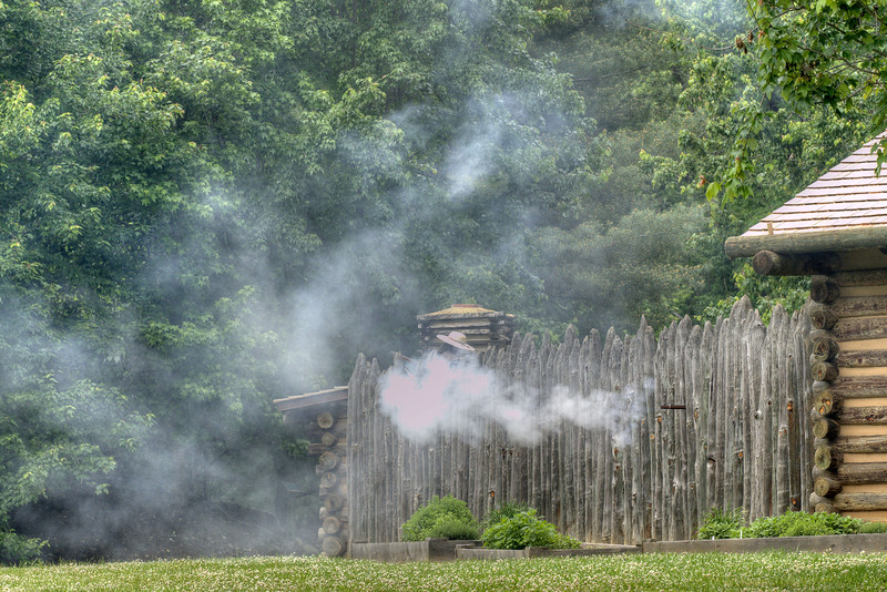 Rifles fire from the walls of the fort during the Siege of Fort Watauga at Sycamore Shoals State Park in Elizabethton, VA on Saturday, May 17, 2014. Copyright 2014 Jason Barnette  The Siege of Fort Watauga is a two-day reenactment held each year at the recreation of the fort inside Sycamore Shoals State Historic Park. The reenactment brings in dozens of reenactors and hundreds of visitors as they tell the story of an attack on the early settlers village by Dragging Canoe, and how they successfully defended themselves. During the reenactment, the fort is open to the public with demonstrations of all areas of early settler life on the frontiers.