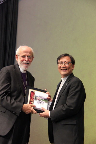 Bishop Philip Oi Peng Lok of the Lutheran Church in Malaysia and Singapore presents gifts for the ELCA to Presiding Bishop Mark S. Hanson.
