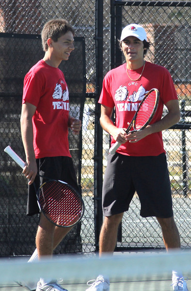 Roman Piftor (L) and Korhan Ates (R) celebrate a doubles' match victory against their Anderson University opponents.