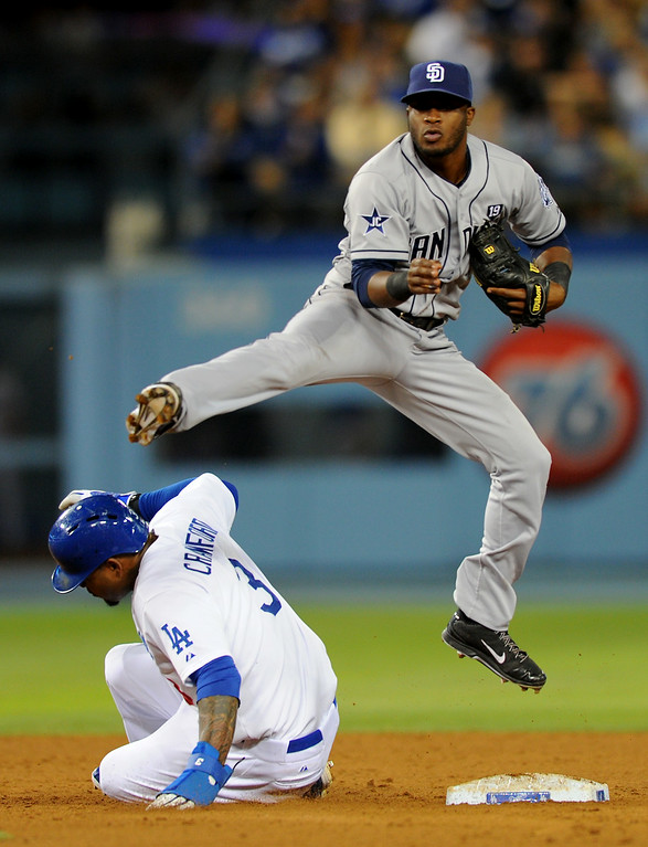 . Padres second baseman Irving Falu leaps over the Dodgers Carl Crawford on a force play at second base, Friday, July 11, 2014, at Dodger Stadium. (Photo by Michael Owen Baker/Los Angeles Daily News)