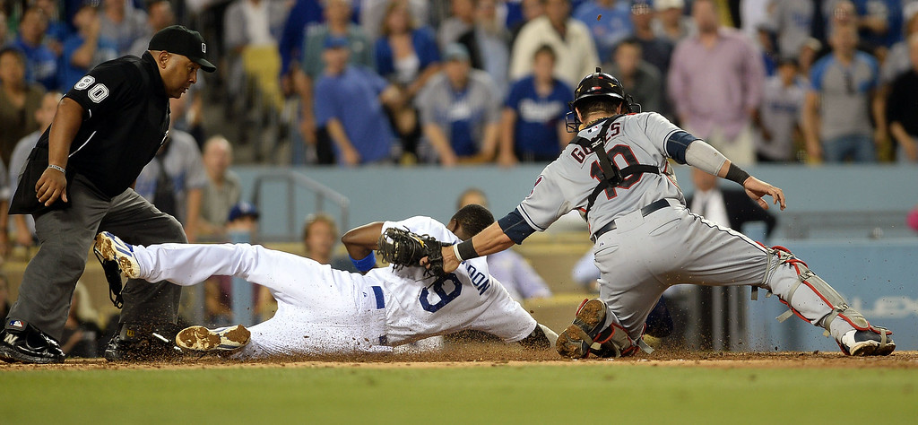 . Los Angeles Dodgers Dee Gordon is tagged out at home during a Cleveland Indians triple play  July 1, 2014 in Los Angeles.(Andy Holzman/Los Angeles Daily News)