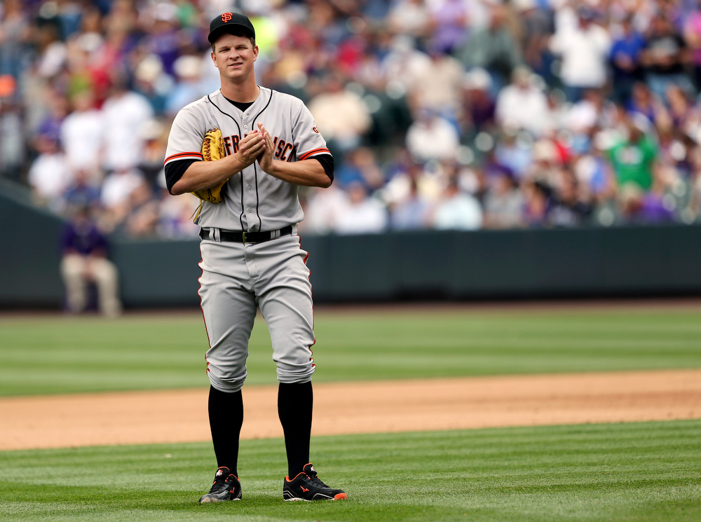 . San Francisco Giants starting pitcher Matt Cain reacts after giving up a solo home run to Colorado Rockies\' Charlie Blackmon in the fourth inning of a baseball game in Denver on Wednesday, April 23, 2014. (AP Photo/David Zalubowski)
