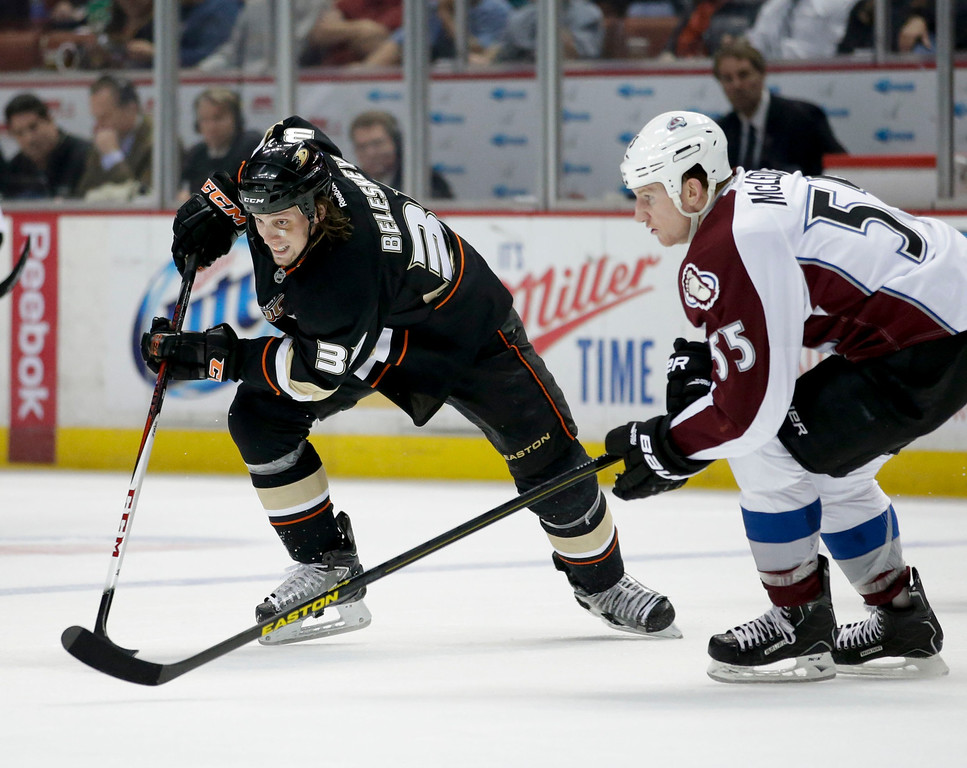. Anaheim Ducks\' Matt Beleskey, left, and Colorado Avalanche\'s Cody McLeod skate during the first period of an NHL hockey game in Anaheim, Calif., Wednesday, April 10, 2013. (AP Photo/Jae C. Hong)