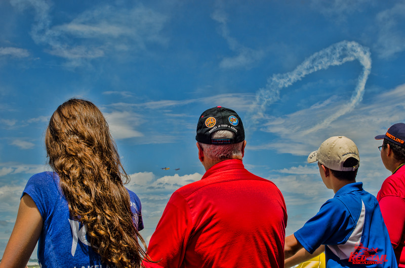 Watching the air show with young award winners.
