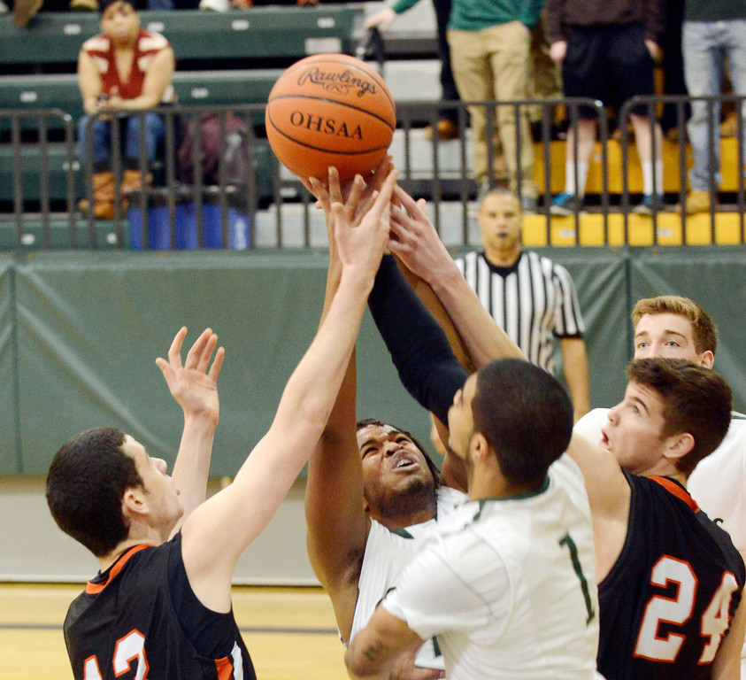 . Maribeth Joeright/MJoeright@News-Herald.com<p> Chagrin\'s Jack Karyo, left, and Sawyer McGuire battle for the rebound with Lake\'s Kareem Haddix, left, and Zavier Powers during the first quarter of the Division II district final game, March 8, 2014.