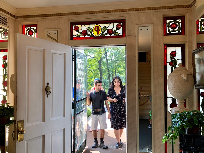 two people waiting outside door at Graceland mansion